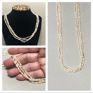 "Rice pearls necklace, 24."" Long, gold tone clasp"